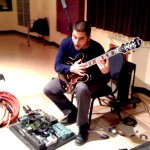 alee karim on electric guitar